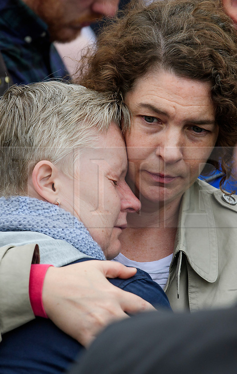 © Licensed to London News Pictures. 05/06/2017. London, UK. Two women embrace during  minutes silence at a vigil at Potters Fields Park outside City Hall in London for those who lost their lives in the London Bridge terror attack. Three men attacked members of the public  after a white van rammed pedestrians on London Bridge. Ten people including the three suspected attackers were killed and 48 injured in the attack. Photo credit: Ben Cawthra/LNP