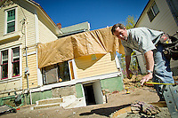 Dan Kirkpatrick, owner of Blueback Construction, takes measurements for an addition he was building Friday at a 115-year-old house in downtown Coeur d'Alene.