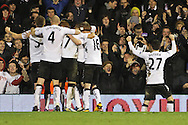 Picture by David Horn/Focus Images Ltd +44 7545 970036.30/01/2013.Fulham players celebrate their team's third goal by Mladen Petric of Fulham during the Barclays Premier League match at Craven Cottage, London.