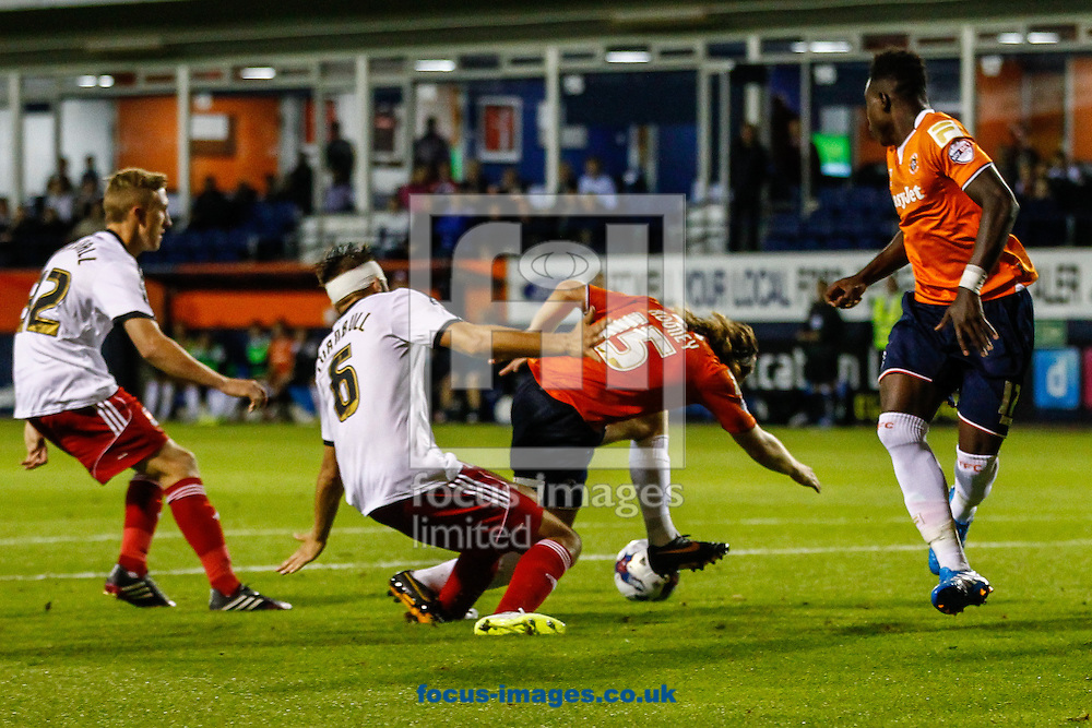 Luke Rooney of Luton Town (15) is judged to have dived in the box under pressure from Jordan Turnbull of Swindon Town (06) during the Capital One Cup match at Kenilworth Road, Luton<br /> Picture by David Horn/Focus Images Ltd +44 7545 970036<br /> 12/08/2014