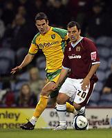 Photo: Paul Thomas.<br /> Burnley v Norwich City. Coca Cola Championship. 23/10/2007.<br /> <br /> Jason Shackell (L) of Norwich covers goal scorer Robbie Blake of Burnley.