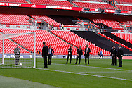 Picture by Andrew Tobin/Focus Images Ltd +44 7710 761829<br /> 14/08/2013<br />  Match officials inspect the goal and test the goal line technology before the International Friendly match at Wembley Stadium, London.