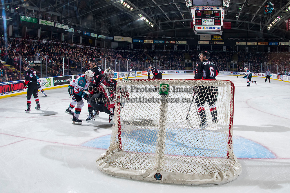 KELOWNA, CANADA - JANUARY 4:  Kyle Topping #24 of the Kelowna Rockets gets caught up with Taylor Gauthier #35 of the Prince George Cougars on January 4, 2019 at Prospera Place in Kelowna, British Columbia, Canada.  (Photo by Marissa Baecker/Shoot the Breeze)