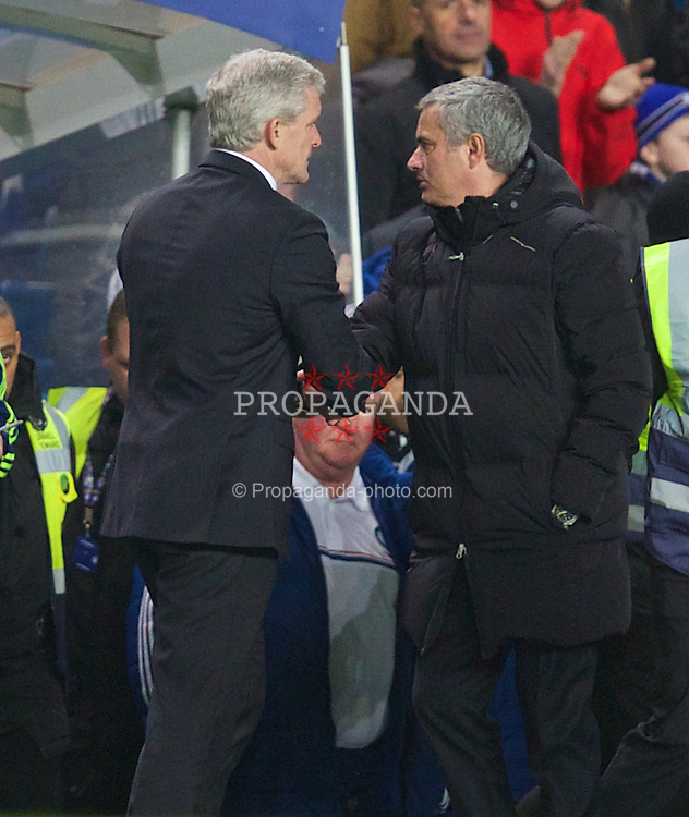 LONDON, ENGLAND - Sunday, January 26, 2014: Chelsea's manager Jose Mourinho shakes hands with Stoke City's manager Mark Hughes after the 1-0 victory during the FA Cup 4th Round match at Stamford Bridge. (Pic by David Rawcliffe/Propaganda)