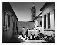 Minaret of neighboring mosques towers over doctors and graduate medical students who enter drug dependency ward at Kabul's only gov?t run mental hospital, Psychiatric and Drug Dependency Hospital, Kabul, Afghanistan.  The detox program at the hospital is only for ten days.  The only medicine offered detox patients is ibuprofen.  The success rate is well below 50%, says Dr. Qureshi, Deputy Director of the hospital.