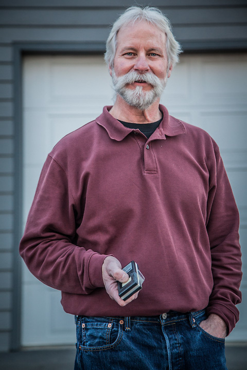 "Neighbor Greg Pittman in front of his garage in Anchorage's South Additiona neighborhood.  ""I'm a transplant…came up from Arkansas 25 years ago…Anchorage has been good to me.""  akmetal@alaska.net"