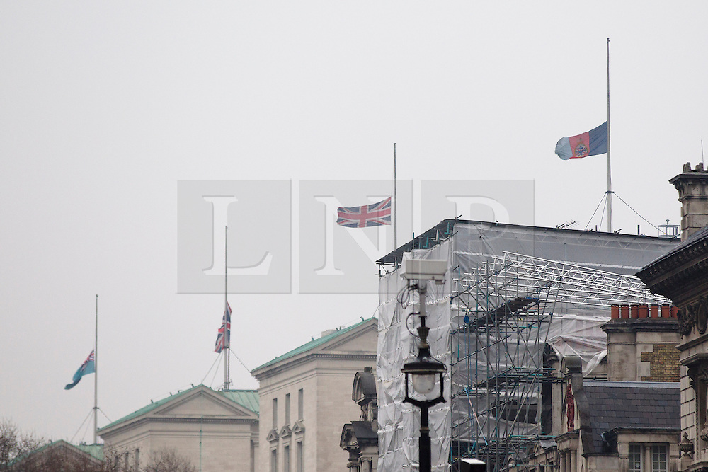 © Licensed to London News Pictures. 09/04/2013. London, UK. Flags on the roof of the British Ministry of Defence in London are seen flying at half mast as a sign of respect for former British Prime Minister Baroness Thatcher who died yesterday (08/04/2013) after a stroke. Photo credit: Matt Cetti-Roberts/LNP