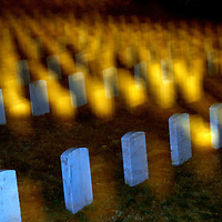 Night view of tombstones in the Arlington National Cemetery.