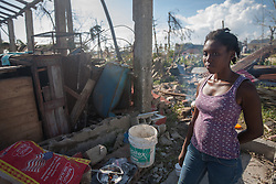 October 7, 2016 - Port Salute, Haiti - A woman stands in front of the remains of her house in Port Salute that was destroyed by hurricane Matthew, on October 7, 2016. Hurricane Matthew killed almost 900 people and displaced tens of thousands in Haiti before plowing northward on Saturday just off the southeast U.S. coast, where it caused major flooding and widespread power outages. (Credit Image: © Bahare Khodabande/NurPhoto via ZUMA Press)
