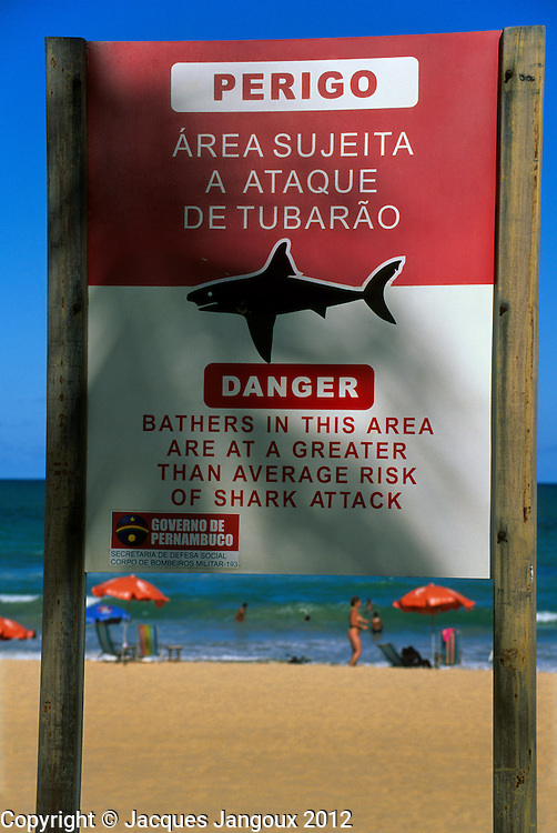 Bilingual Portuguese - English sign saying: Danger area subject to shark attack, at Boa Viagem Beach, Recife, Pernambuco, Brazil
