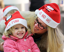 Janine Adamson and her daughter Maizie (2) from Southampton at London Gatwick airport as they prepare to jet off to Tenerife as the Christmas getaway starts Friday, 20th December 2013. Picture by Stephen Lock / i-Images