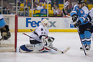 18 February, 2006 - Anchorage, AK:  Long Beach IceDogs goal tender Jaroslav Halak deflects a shot by Aces Right Wing, Cam Keith (22 in blue) as the IceDogs go on to beat the home team Alaska Aces 4-1 at the Sullivan Arena.