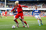Charlton Athletic striker Simon Makienok (9) holds off Queens Park Rangers defender Nedum Onuoha (5) during the Sky Bet Championship match between Queens Park Rangers and Charlton Athletic at the Loftus Road Stadium, London, England on 9 April 2016. Photo by Andy Walter.