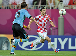 (R) Croatia's Danijel Pranjic (nr06) fights for the ball with (L) Spain's Sergio Ramos (nr15) during the UEFA EURO 2012 Group C football match between Spain and Croatia at Gdansk Arena in Gdansk on June 18, 2012...Poland, Gdansk, June 18, 2012..Picture also available in RAW (NEF) or TIFF format on special request...For editorial use only. Any commercial or promotional use requires permission...Photo by © Adam Nurkiewicz / Mediasport