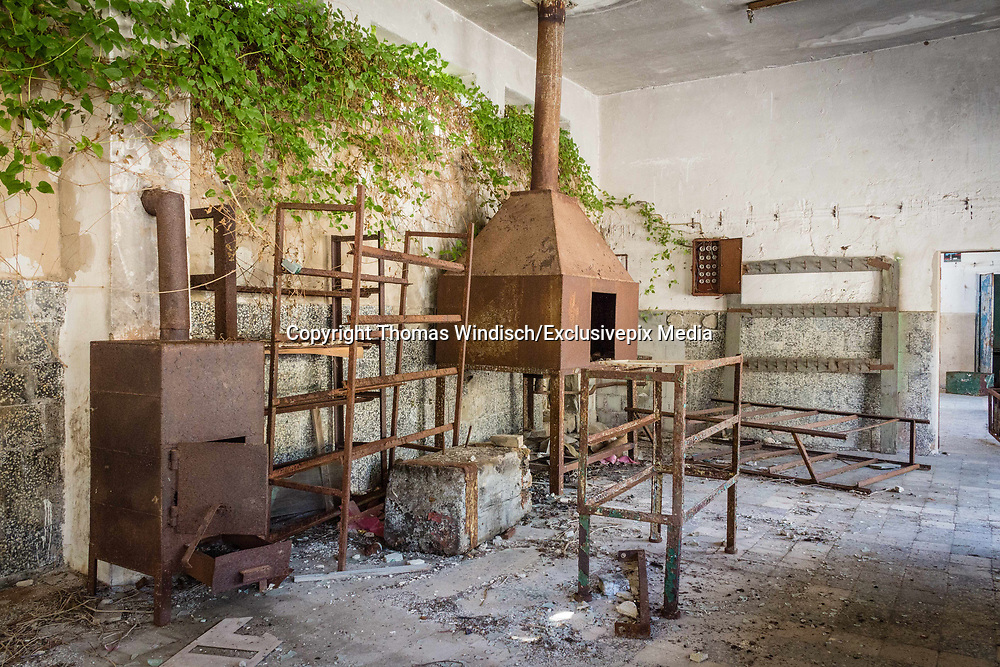 """Stunning images of the Abandoned political prison in Croatia <br /> <br /> Goli otok  meaning """"barren island""""; is a barren, uninhabited island that was the site of a political prison in use when Croatia was part of Yugoslavia. The prison was in operation between 1949 and 1989. The island is located in the northern Adriatic Sea just off the coast of Primorje-Gorski Kotar County, Croatia with an area of approximately 4 square kilometers (1.54 square miles).<br /> <br /> Despite having long been an occasional grazing ground for local shepherds' flocks, the barren island was apparently never permanently settled other than during the 20th century. Throughout World War I, Austria-Hungary sent Russian prisoners of war from the Eastern Front to Goli otok.<br /> Goli otok seen from the mainland<br /> <br /> In 1949, the entire island was officially made into a high-security, top secret prison and labor camp run by the authorities of the Socialist Federal Republic of Yugoslavia, together with the nearby Sveti Grgur island, which held a similar camp for female prisoners. Until 1956, throughout the Informbiro period, it was used to incarcerate political prisoners. These included known and alleged Stalinists, but also other Communist Party of Yugoslavia members or even non-party citizens accused of exhibiting sympathy or leanings towards the Soviet Union. Many anticommunist (Serbian, Croatian, Macedonian, Albanian and other nationalists etc.) were also incarcerated on Goli otok. Non-political prisoners were also sent to the island to serve out simple criminal sentences and some of them were sentenced to death. A total of approximately 16,000 political prisoners served there, of which between 400 and 600 died on the island.<br /> <br /> The prison inmates were forced to labor (in a stone quarry, pottery and joinery), without regard to the weather conditions: in the summer the temperature would rise as high as 35 to 40 °C (95 to 104 °F), while in the winter they were subjected to """