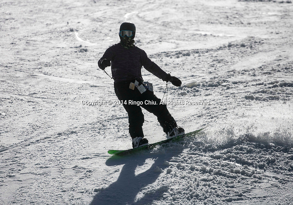 A snowboarder shows off at Mountain High resort in Wrightwood , California Friday January 3, 2014. Warm temperatures hit Southern California, which stand in stark contrast to record snowfall in the east. According National Weather Service, a record high temperature of 68 degrees was set at Sandberg, California today. This tied the old record of 68 set in 2012.    (Photo by Ringo Chiu/PHOTOFORMULA.com)