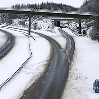 Perthshire Heavy Snow...<br /> A crashed car abandoned on the deserted M90 in Perth after heavy overnight snow left whiteout conditions the town<br /> Picture by Graeme Hart.<br /> Copyright Perthshire Picture Agency