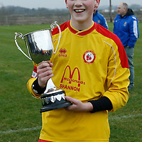 A delighted Avenue Utd Captain Donal O'Halloran displays the winning silverware<br />Photograph by Flann Howard