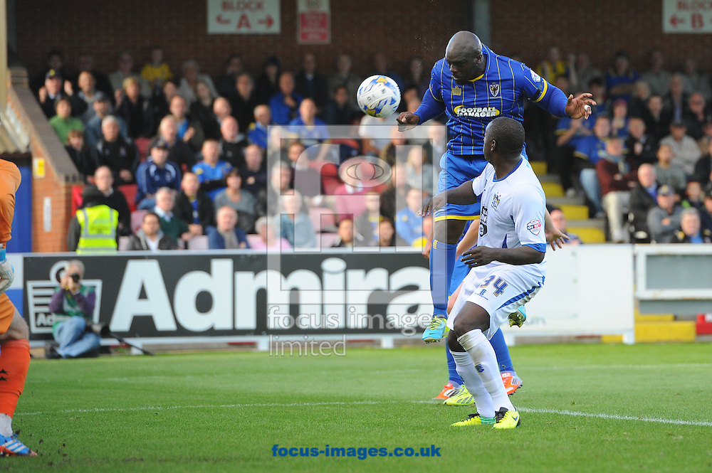 Adebayo Akinfenwa of AFC Wimbledon leaps to score a second goal with a header during the Sky Bet League 2 match at the Cherry Red Records Stadium, Kingston<br /> Picture by Seb Daly/Focus Images Ltd +447738 614630<br /> 11/10/2014