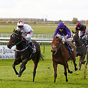Winter Song and Michael Hills winning the 12.40 race