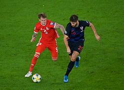 CARDIFF, WALES - Sunday, October 13, 2019: Wales' Joe Rodon (L) and Croatia's Bruno Petković during the UEFA Euro 2020 Qualifying Group E match between Wales and Croatia at the Cardiff City Stadium. (Pic by Paul Greenwood/Propaganda)