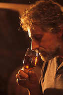 France Man drinking Cavados alccol in a cellar   Normandie  France