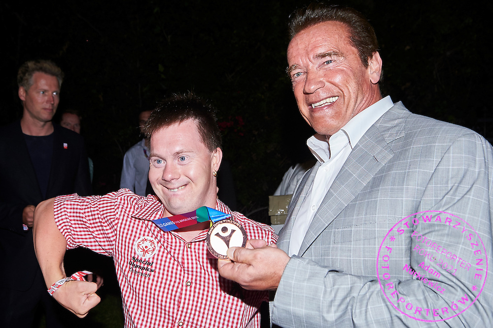 (R) Arnold Schwarzenegger Special Olympics Austria Honorary President and (L) Alexander Radin SO Austria athlete pose to picture while Austria 2017 Reception during third day of the Special Olympics World Games Los Angeles 2015 on July 27, 2015 in Los Angeles, USA.<br /> USA, Los Angeles, July 27, 2015<br /> <br /> Picture also available in RAW (NEF) or TIFF format on special request.<br /> <br /> For editorial use only. Any commercial or promotional use requires permission.<br /> <br /> Adam Nurkiewicz declares that he has no rights to the image of people at the photographs of his authorship.<br /> <br /> Mandatory credit:<br /> Photo by © Adam Nurkiewicz / Mediasport
