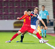 FYR Macedonia's Kire Markoski' holds off Scotland's Stephen Kingsley during Scotland Under-21 v FYR Macedonia,  UEFA Under 21 championship qualifier  at Tynecastle, Edinburgh. Photo: David Young<br /> <br />  - © David Young - www.davidyoungphoto.co.uk - email: davidyoungphoto@gmail.com