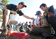 FALMOUTH -- 101313 -- Michael Wheeler, 15, from Troop 38 of North Falmouth negotiates a trade of council shoulder patches for a deck of cards with Randall Scroggins, 13, and Ben Parsons, 12, both from Troop 256 of Plymouth, N.H. during the MassJam 2013 at Cape Cod Fairgrounds.