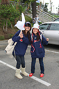 LOS ANGELES, CA - MARCH 22: Fans of Japan hold flags and wear special hats in the parking lot before their team plays against USA in game two of the semifinal round of the 2009 World Baseball Classic at Dodger Stadium in Los Angeles, California on Sunday March 22, 2009. Japan defeated USA 9-4. (Photo by Paul Spinelli/WBCI/MLB Photos)