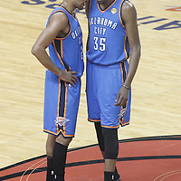 21 June 2012: Oklahoma City Thunder shooting guard Thabo Sefolosha (2) talks to Oklahoma City Thunder small forward Kevin Durant (35) during the Miami Heat 121-106 victory over the Oklahoma City Thunder, in Game 5 of the 2012 NBA Finals, at the AmericanAirlinesArena, Miami, Florida, USA. The Miami Heat wins the series 4-1.