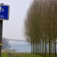 An inviting sign to enjoy a stroll alongside the canal