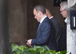 © Licensed to London News Pictures. 13/06/2019. London, UK. Conservative Party leadership candidate Dominic Raab checks his phone as he walks in Parliament with David Davis (R) after the first vote.  Boris Johnson received most votes with Mark Harper, Andrea Leadsom and Esther McVey all not receiving enough votes to carry on to the second round next week. Photo credit: Peter Macdiarmid/LNP