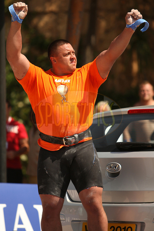 Mikhail Koklyaev (Russia) acknowledges the crowd before the deadlift (for time) during one of the qualifying rounds of the World's Strongest Man competition held in Sun City, South Africa.