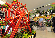 A floral ferris wheel at the 43rd Annual Macy's Flower Show, Carnival, leads visitors into the Scent Event experience, Sunday, March 26, 2017, at Macy's Herald Square in New York. The floral show runs through Sunday, April 9 and the Scent Event runs through Saturday, April 22, both are free to the public. (Photo by Diane Bondareff/AP Images for Macy's Inc.)