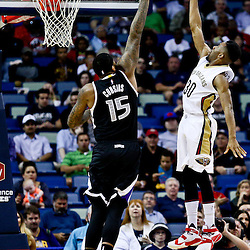 Mar 7, 2016; New Orleans, LA, USA; New Orleans Pelicans guard Norris Cole (30) shoots over Sacramento Kings center DeMarcus Cousins (15) during the first quarter of a game at the Smoothie King Center. Mandatory Credit: Derick E. Hingle-USA TODAY Sports
