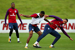 England's Raheem Sterling takes on Chris Smalling - Mandatory by-line: Matt McNulty/JMP - 29/08/2017 - FOOTBALL - St George's Park National Football Centre - Burton-upon-Trent, England - England Training and Press Conference