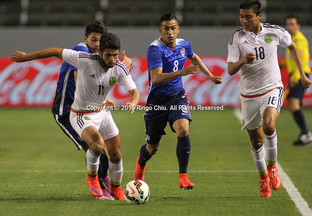 United States' Oscar Sorto #20 and Benji Joya #8 action against Mexico's Daniel Hern‡ndez Trejo #11 and Rosario Enrique Cota Carrazco #18 during a men's national team international friendly match, April 22, 2015, at StubHub Center in Carson, California. United States won 3-0. (Photo by Ringo Chiu/PHOTOFORMULA.com)