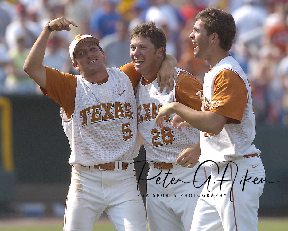 Texas Longhorns Jordon Street (5), Zach Gallenkamp (28) and Thomas Incaviglia (R), celebrate after defeating Florida for the National Championship.  Texas defeated Florida 6-2 for the National Championship at the College World Series at Rosenblatt Stadium in Omaha, Nebraska on June 26, 2005.