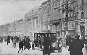 Moment when a shot is fired from a window on the Nevsky Prospect, main street in Petrograd, later St Petersburg, during the Russian Revolution, photograph by Daily Mirror, published in L'Illustration no.3867, 14th April 1917. Picture by Manuel Cohen