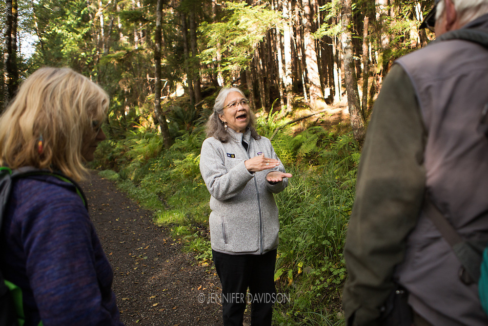 Haida guide Linda Tollas talks to guests from the National Geographic Sea Lion on the Spirit Lake Trail, a trail system she helped create outside Queen Charlotte City, Haida Gwaii.