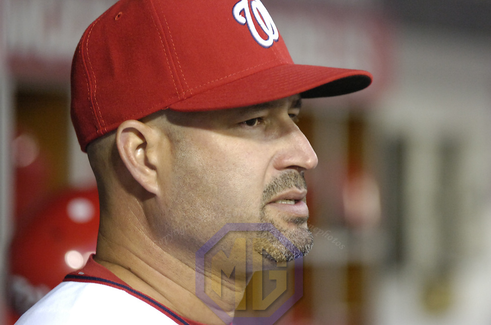 22 June 2007:  Washington Nationals manager Manny Acta gives the signs from the dugout in action against the Cleveland Indians.  The Nationals defeated the Indians 4-1 in inter-league play at RFK Stadium in Washington, D.C.  ****For Editorial Use Only****
