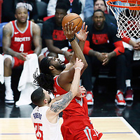28 February 2018: Houston Rockets center Nene Hilario (42) is fouled by LA Clippers guard Austin Rivers (25) during the Houston Rockets 105-92 victory over the LA Clippers, at the Staples Center, Los Angeles, California, USA.