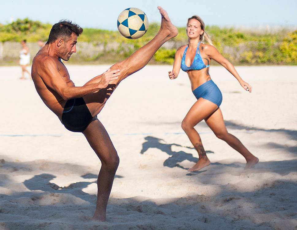 A game called Footvolley is played on Miami Beach. Footvolley combines the rules of football (soccer) and beach volleyball to create a hybrid game where beach volleyball is played but using football rules as far as not being allowed to use hands to control the ball.