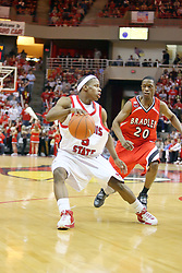 "03 February 2007: Keith ""Boo"" Richardson makes a move on Daniel Ruffin.  In what is locally referred to as the War on Seventy Four, the Bradley Braves defeated the Illinois State University Redbirds 70-62 on Doug Collins Court inside Redbird Arena in Normal Illinois."