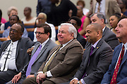 North Charleston Mayor Keith Summey smiles as Rev. Al Sharpton addresses a healing service at Charity Missionary Baptist Church April 12, 2015 in North Charleston, South Carolina. Sharpton spoke following the recent fatal shooting of unarmed motorist Walter Scott police and thanked the Mayor and Police Chief for doing the right thing in charging the officer with murder.