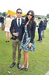 WAYNE YIP and GEMMA CHAN at the 2011 Veuve Clicquot Gold Cup Final at Cowdray Park, Midhurst, West Sussex on 17th July 2011.