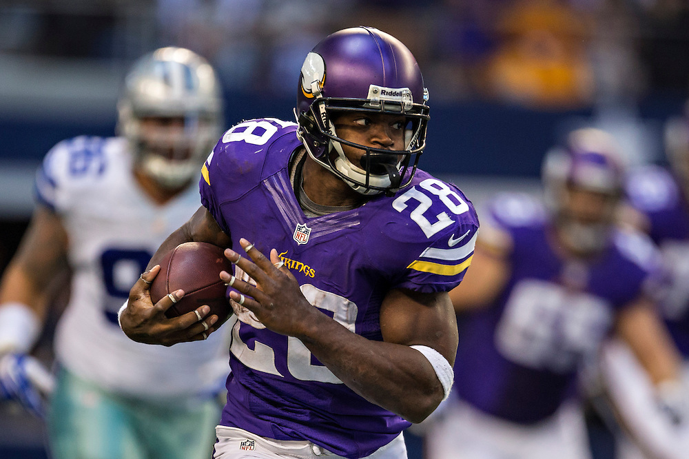 ARLINGTON, TX - NOVEMBER 3:  Adrian Peterson #28 of the Minnesota Vikings runs the ball against the Dallas Cowboys at  AT&T Stadium on November 3, 2013 in Arlington, Texas.  The Cowboys defeated the Vikings 27-23.  (Photo by Wesley Hitt/Getty Images) *** Local Caption *** Adrian Peterson