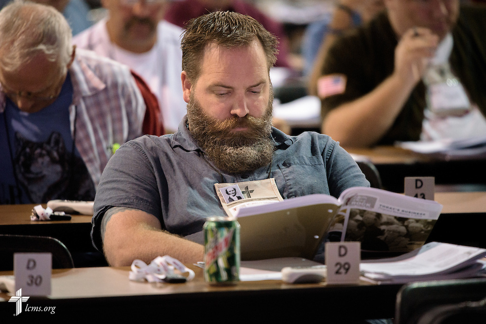 A voting delegate reads Today's Business on Thursday, July 14, 2016, at the 66th Regular Convention of The Lutheran Church–Missouri Synod, in Milwaukee. LCMS/Frank Kohn