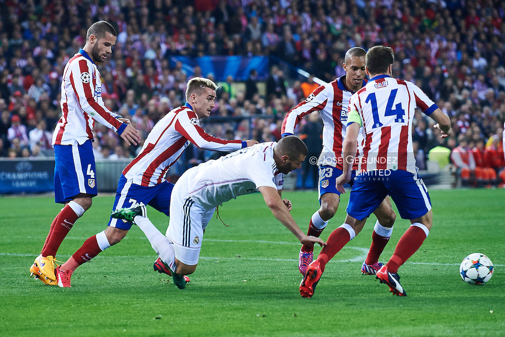Miranda, Griezmann, Mario Suarez and Karim Benzema (Real Madrid F.C.) in action during the Champions League, round of 4 match between Atletico de Madrid and Real Madrid at Estadio Vicente Calderon on April 14, 2015 in Madrid, Spain